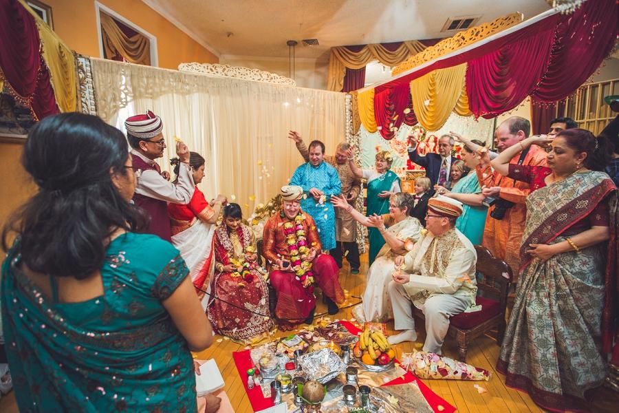 rose petals being thrown at bride and groom calgary hindu wedding hare krishna anna michalska