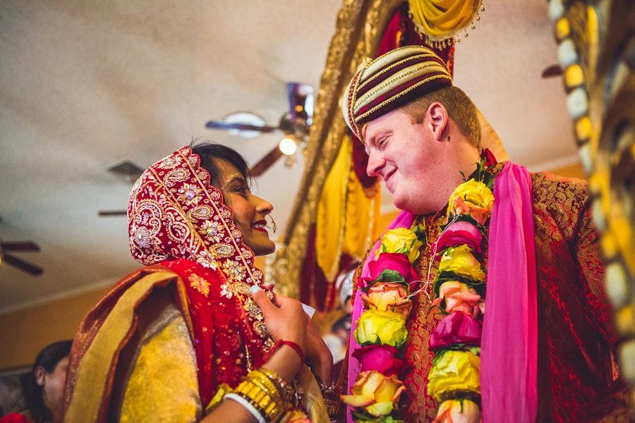 bride and groom smile Saptapadi  calgary hindu wedding hare krishna anna michalska