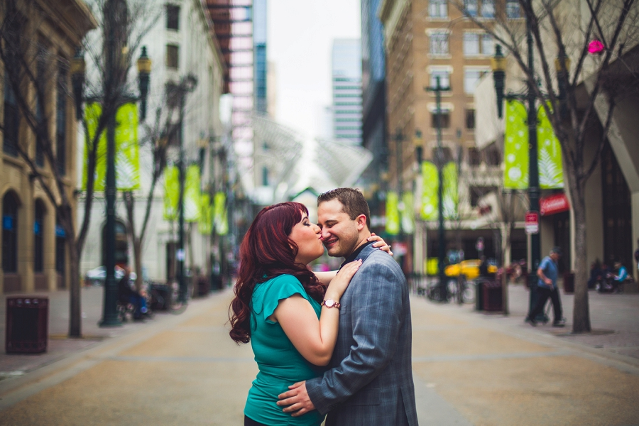 calgary downtown engagement photos stephen ave city trees couple kiss anna michalska photography