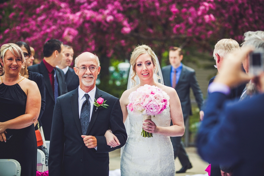 valley ridge golf calgary wedding photographer anna michalska bride walks down aisle