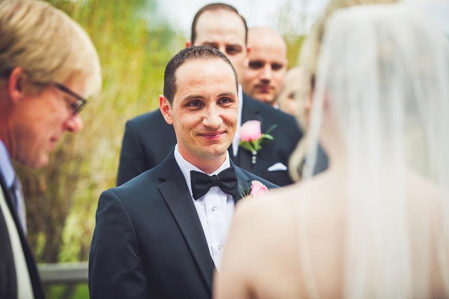 valley ridge golf calgary wedding photographer anna michalska groom smiles at bride ceremony