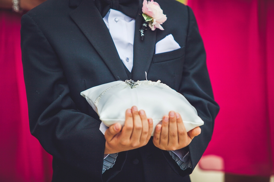valley ridge golf calgary wedding photographer anna michalska ring bearer holds pillow