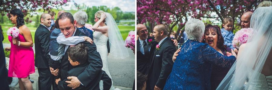 valley ridge golf calgary wedding photographer anna michalska guests hugging