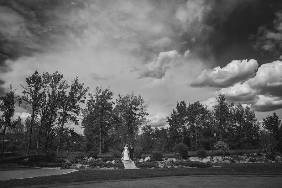 black white bride groom from far away valley ridge golf calgary wedding photographer anna michalska
