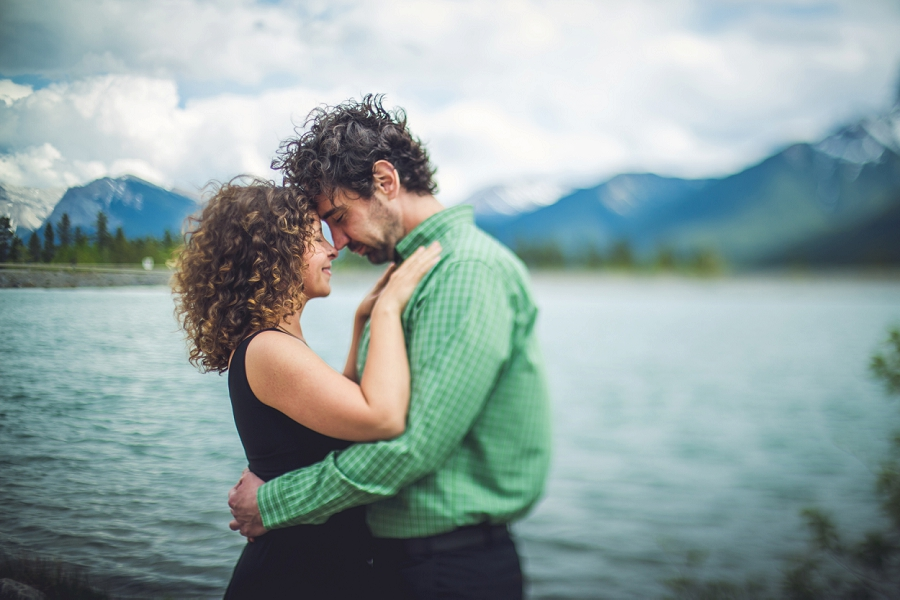 curly haired couple rocky mountain engagement calgary wedding photographer anna michalska