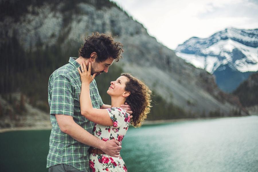 couple embrace rocky mountain engagement calgary wedding photographer anna michalska