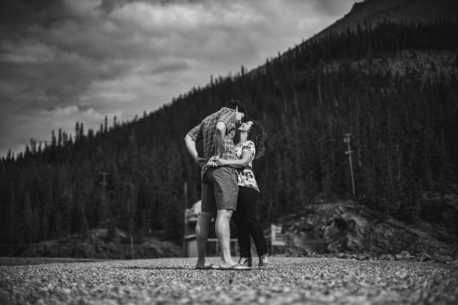 black and white couple embrace rocky mountain engagement calgary wedding photographer anna michalska
