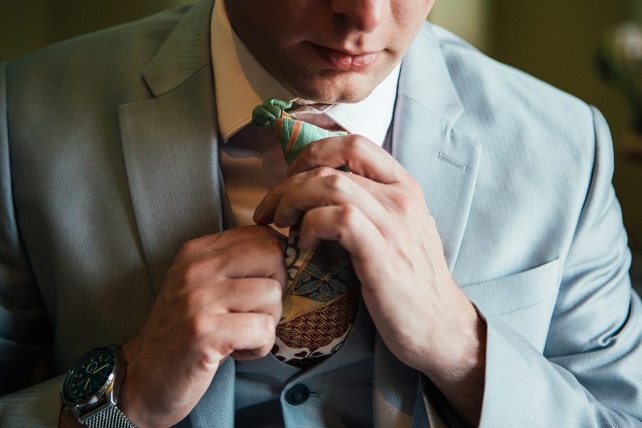 calgary wedding photographer emerald lake lodge anna michalska groom tie