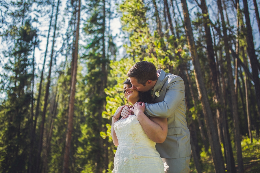 groom kiss bride calgary wedding photographer emerald lake lodge anna michalska