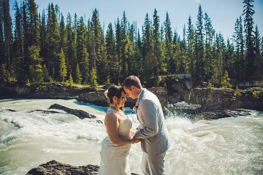bride and groom over falls calgary wedding photographer emerald lake lodge anna michalska