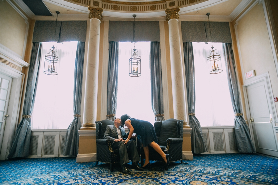 calgary rooftop engagement pictures fairmont palliser kiss couple
