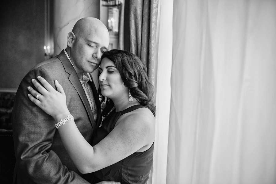 black and white couple calgary rooftop engagement pictures fairmont palliser