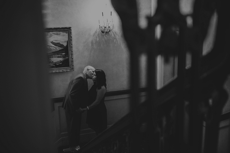 calgary rooftop engagement pictures fairmont palliser kiss in stairwell