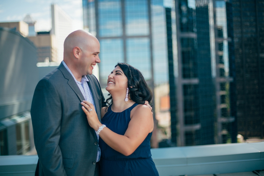 couple laughing anna michalska calgary rooftop engagement pictures sheraton