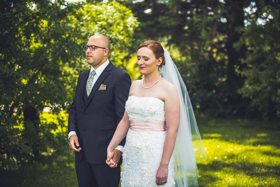 first look bride groom baker park wedding calgary wedding photographers anna michalska