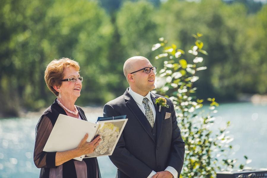 groom looking at bride baker park wedding calgary wedding photographers anna michalska