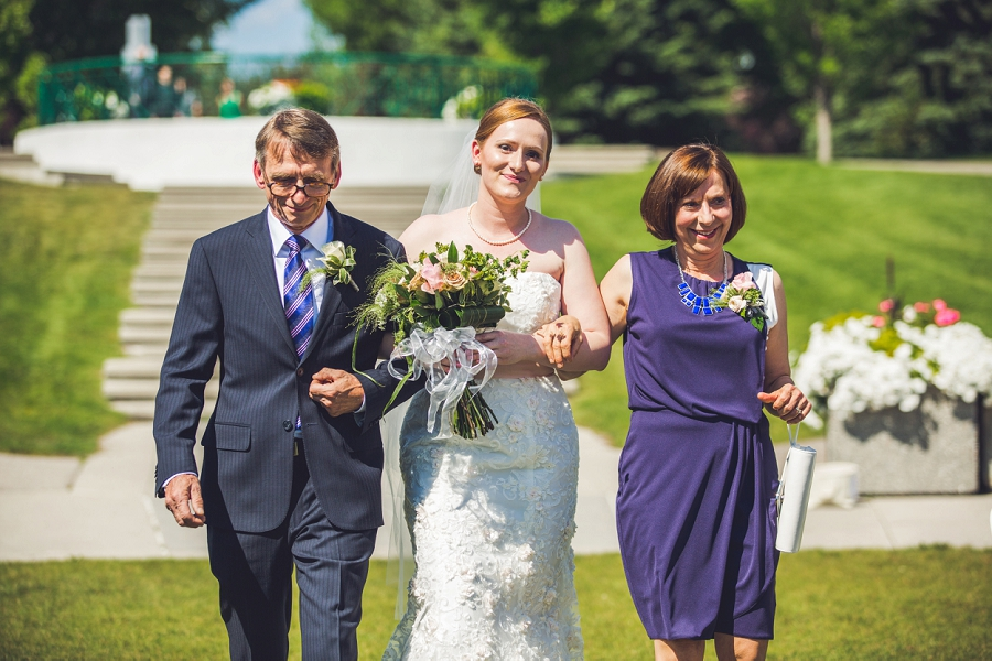bride with parents walking down aisle baker park wedding calgary wedding photographers anna michalska
