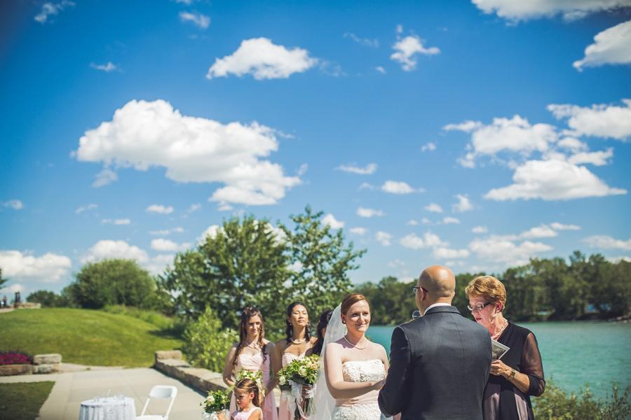 bride looking at groom baker park wedding calgary wedding photographers anna michalska
