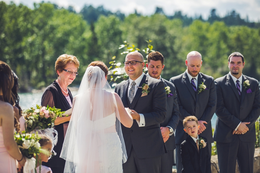 groom smiling at bride baker park wedding calgary wedding photographers anna michalska