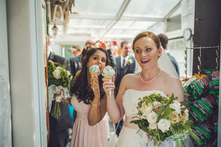 bride with bridesmaid angel's cappuccino and ice cream edworthy park calgary wedding photographers anna michalska