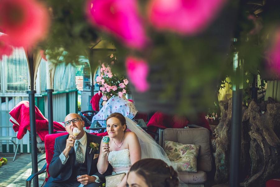 bride groom share ice cream angel's cappuccino and ice cream edworthy park calgary wedding photographers anna michalska