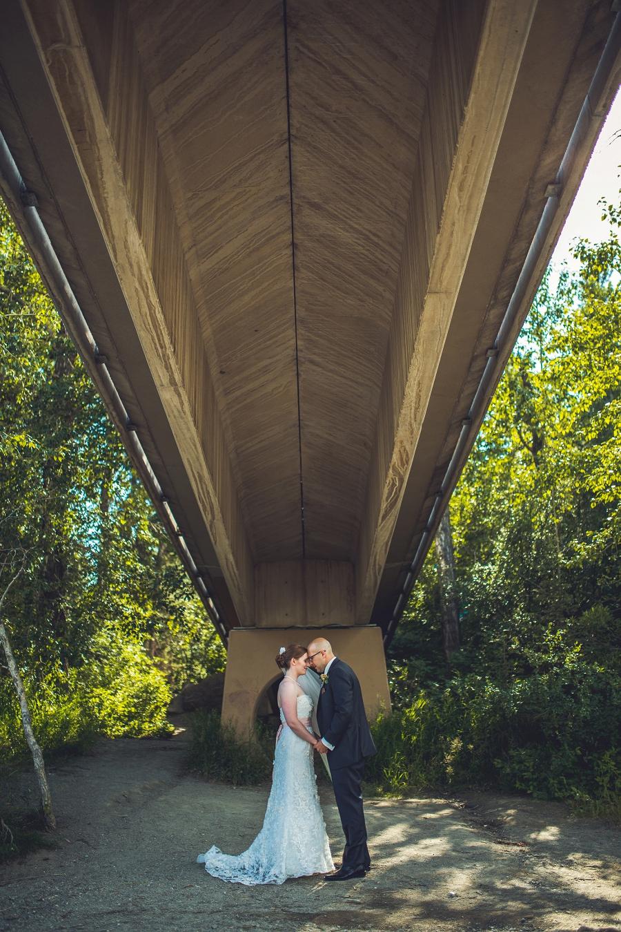 edworthy park calgary wedding photographers anna michalska bride groom under bridge