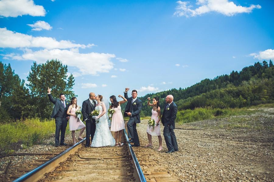 bride groom on train tracks edworthy park calgary wedding photographers anna michalska