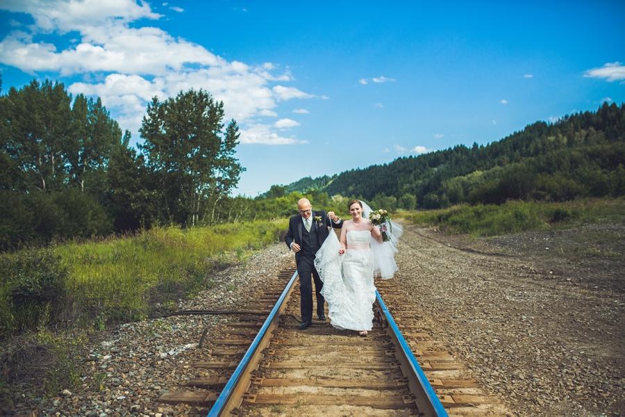 bride groom walking on train tracks edworthy park calgary wedding photographers anna michalska