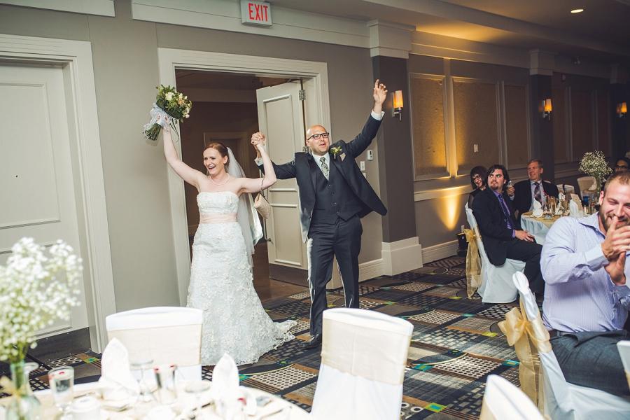 bride groom enter reception executive royal inn calgary wedding photographers anna michalska