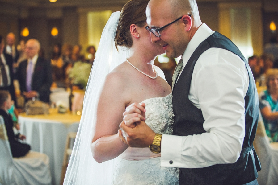 up close bride groom first dance executive royal inn calgary wedding photographers anna michalska