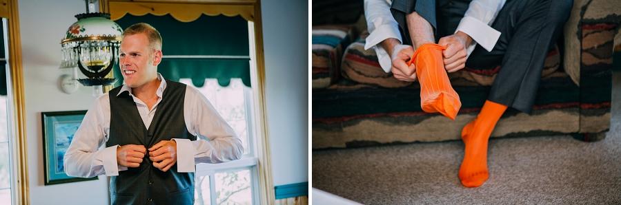 groom getting ready orange socks spring valley chapel rustic wedding alberta calgary photographer anna michalska