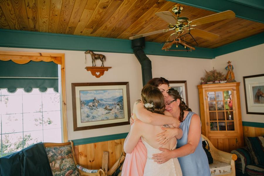 family hug bride spring valley chapel rustic wedding alberta calgary photographer anna michalska