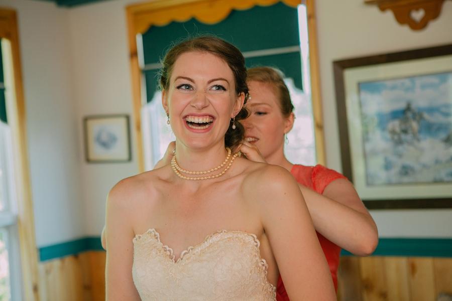 bride laughing spring valley chapel rustic wedding alberta calgary photographer anna michalska