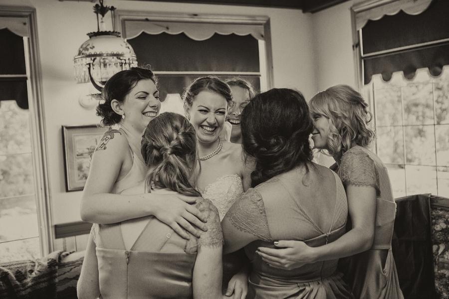 bridesmaid hug spring valley chapel rustic wedding alberta calgary photographer anna michalska