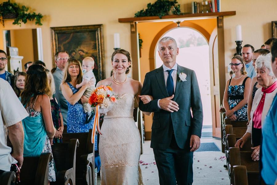spring valley chapel rustic wedding alberta calgary photographer anna michalska bride walking down aisle
