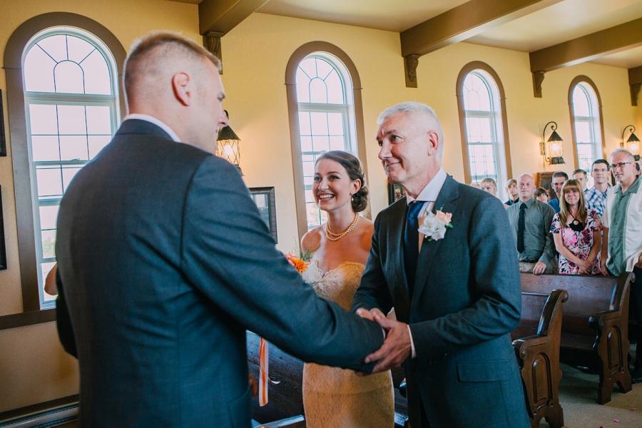 father of bride handshake groom spring valley chapel rustic wedding alberta calgary photographer anna michalska