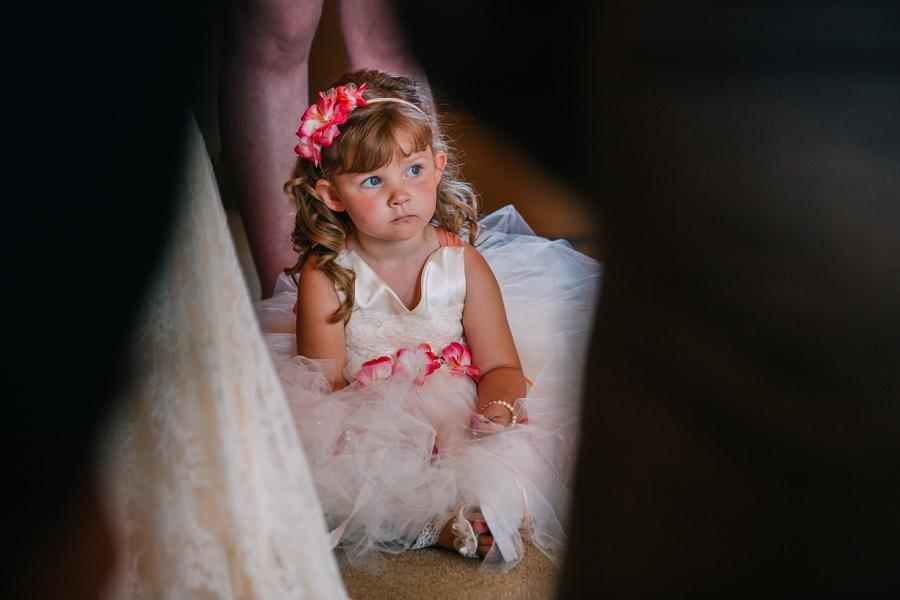 flower girl sitting spring valley chapel rustic wedding alberta calgary photographer anna michalska
