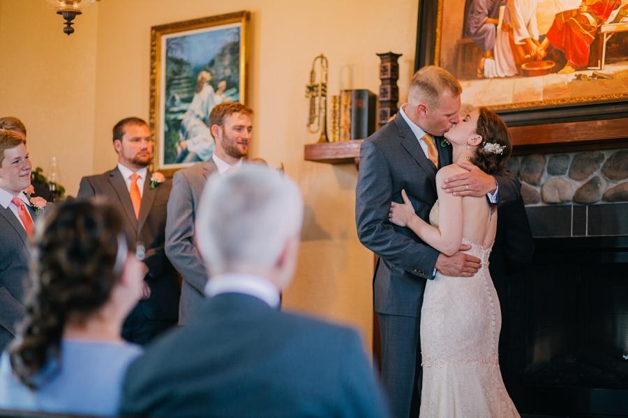 bride groom first kiss spring valley chapel rustic wedding alberta calgary photographer anna michalska