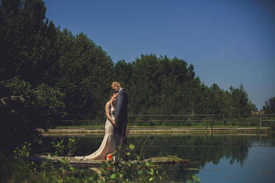 groom bride on lake spring valley chapel rustic wedding alberta calgary photographer anna michalska