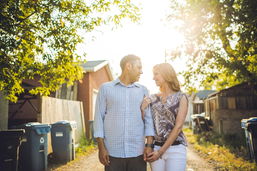 couple in alleyway sunset ramsay calgary engagement photos anna michalska wedding summer