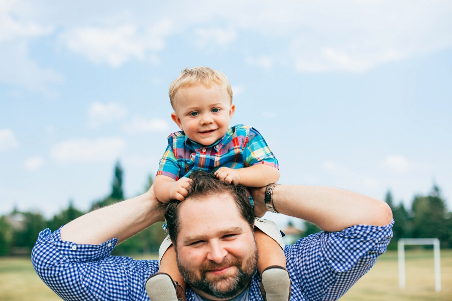 father and son piggyback calgary family photographer candid family photos