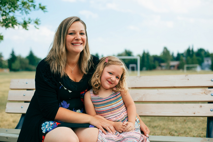 mother and daughter on bench smiling calgary family photographer candid family photos