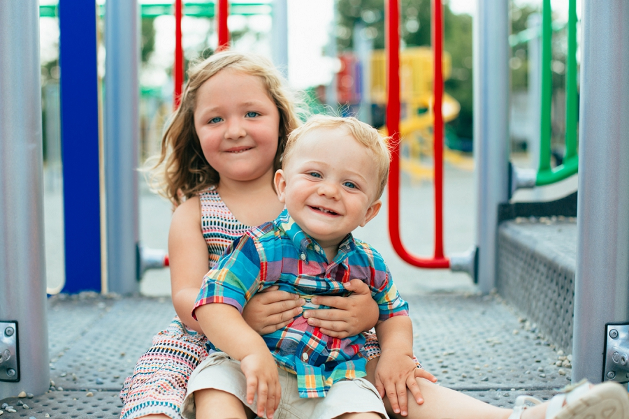 brother and sister playground calgary family photographer candid family photos