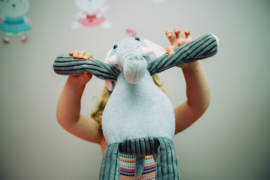 child elephant plush toy calgary family photographer candid family photos