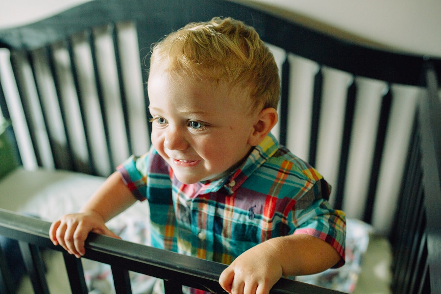 toddler in crib calgary family photographer candid family photos