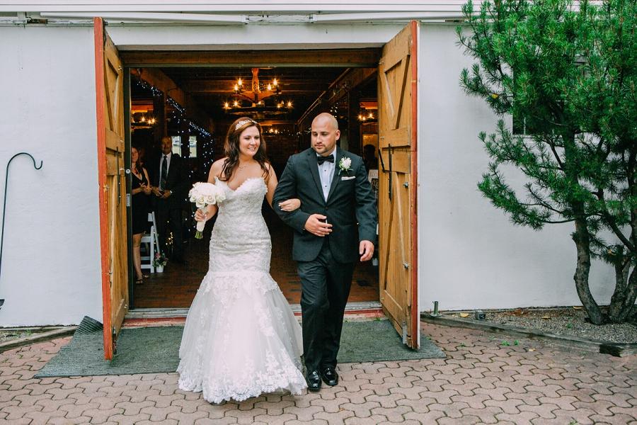 bride groom exit ceremony shawnessy barn calgary wedding photographer anna michalska