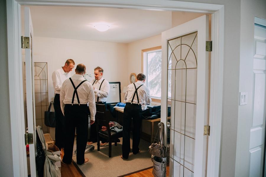 groomsmen getting ready calgary wedding photographers anna michalska