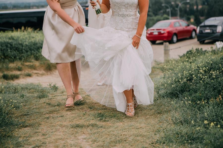 walking up nose hill park bride calgary wedding photographers anna michalska