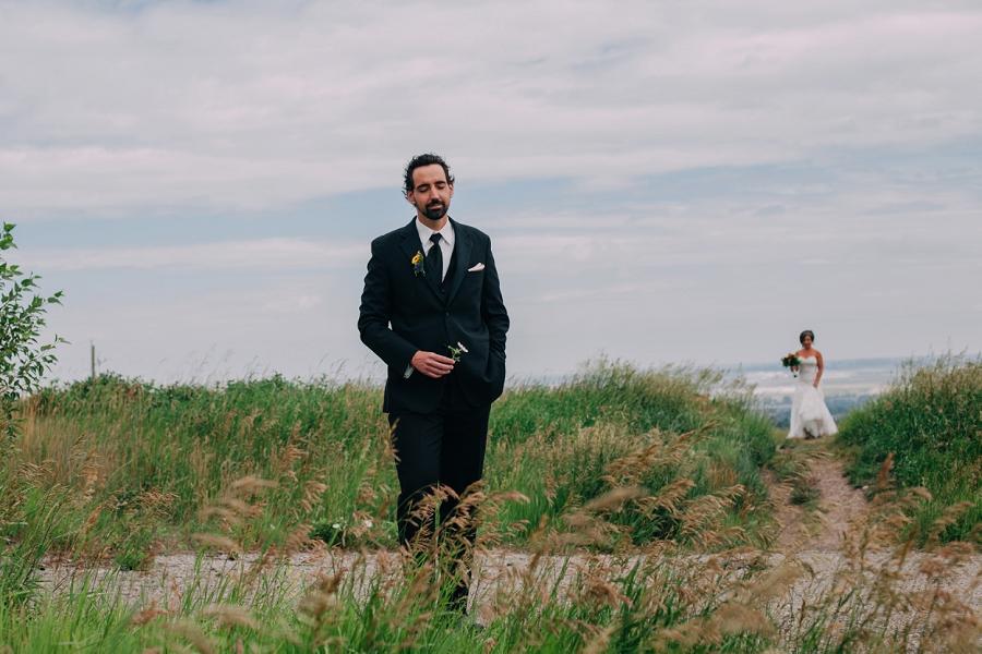 groom bride first look calgary wedding photographers anna michalska