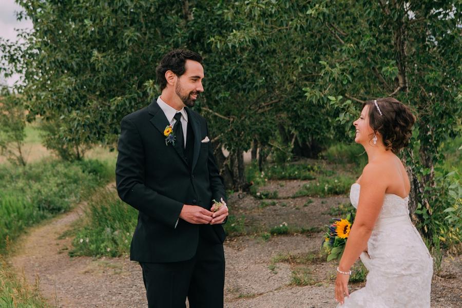 groom sees bride nose hill park calgary wedding photographers anna michalska first look